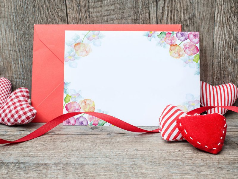 Free-Lovely-Greeting-Card-Mockup-Placing-on-Wood