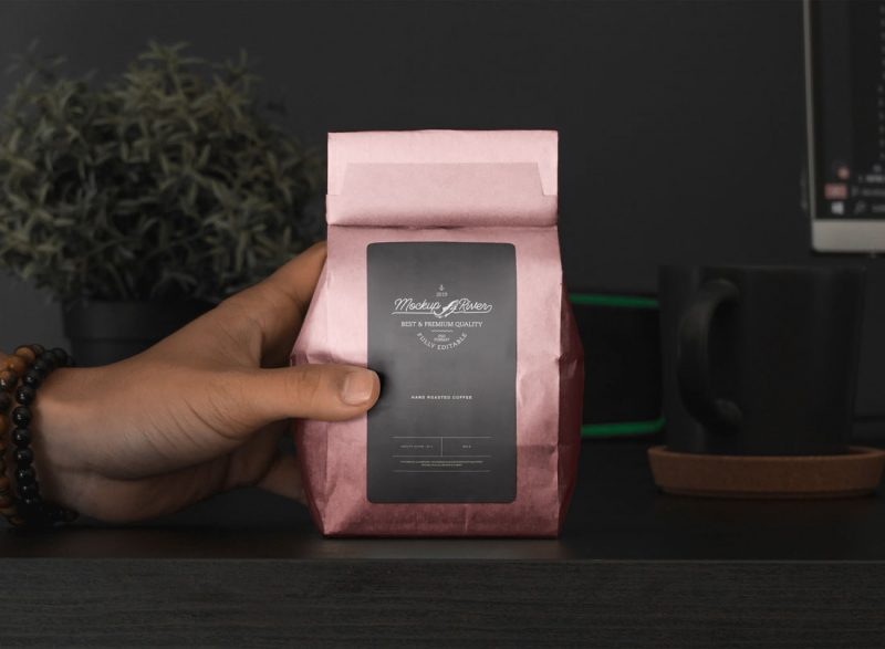 Free-Hand-Holding-Coffee-Pouch-Packaging-Mockup-Design-Template